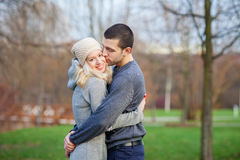 Young attractive couple in love, teenagers having fun outdoors, Stock Images