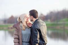 Young attractive couple in love, teenagers having fun outdoors, Royalty Free Stock Image