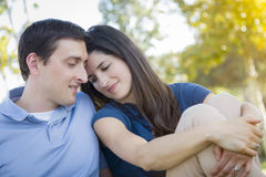 Young Attractive Couple Portrait in Park. Young Attractive Couple Intimate Portrait Outdoors in the Park Royalty Free Stock Image