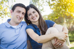 Young Attractive Couple Portrait in Park. Young Attractive Couple Intimate Portrait Outdoors in the Park Stock Photography