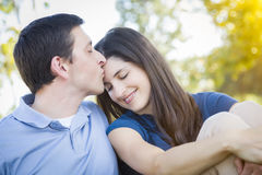 Young Attractive Couple Portrait in Park. Young Attractive Couple Intimate Portrait Outdoors in the Park Stock Images