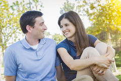 Young Attractive Couple Portrait in Park. Young Attractive Couple Portrait Outdoors in the Park Royalty Free Stock Images