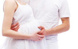 Young attractive couple: pregnant mother and father Stock Images