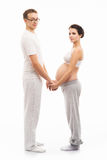 Young attractive couple: pregnant mother and happy father. Image isolated on white Stock Photography
