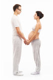 Young attractive couple: pregnant mother and happy father Royalty Free Stock Photo