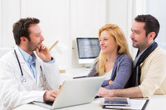 Young attractive couple seeing a doctor Stock Photography