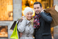 Young attractive couple with shopping bags Stock Photo