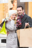 Young attractive couple with shopping bags Royalty Free Stock Image