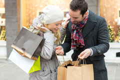 Young attractive couple with shopping bags Royalty Free Stock Photos