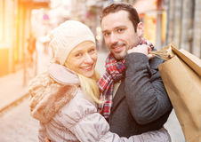 Young attractive couple with shopping bags Royalty Free Stock Images