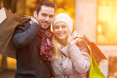 Young attractive couple with shopping bags Stock Image