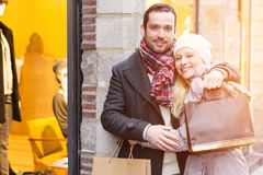 Young attractive couple with shopping bags Stock Photography