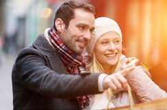 Young attractive couple with shopping bags. View of a Young attractive couple with shopping bags Royalty Free Stock Photos