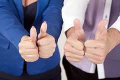 Young attractive couple showing thumbs up.  Royalty Free Stock Photography