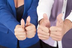 Young attractive couple showing thumbs up.  Royalty Free Stock Images
