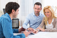 Young attractive couple signing contract on tablet Stock Photography