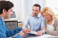 Young attractive couple signing contract Stock Photo