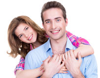 Young attractive couple standing in studio. Portrait of young happy attractive couple standing in studio isolated on white background Royalty Free Stock Photo