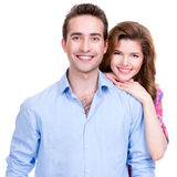 Young attractive couple standing in studio. stock image