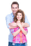 Young attractive couple standing in studio. Portrait of young happy attractive couple standing in studio isolated on white background stock images