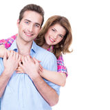 Young attractive couple standing in studio. royalty free stock photography