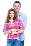 Young attractive couple standing in studio. Royalty Free Stock Images