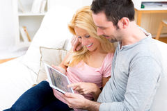 Young attractive couple surfing on internet Royalty Free Stock Images