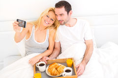 Young attractive couple taking selfie during breakfast Royalty Free Stock Photography