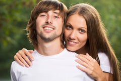Young attractive couple together outdoors. Young happy smiling attractive couple together outdoors Stock Photo