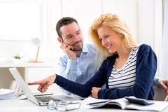 Young attractive couple using laptop at home Royalty Free Stock Image