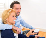 Young attractive couple watching tv Stock Photo