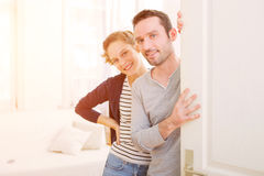 Young attractive couple welcoming you in his house Stock Photo