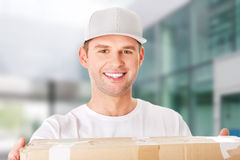 Young attractive courier guy Royalty Free Stock Image