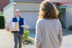 Young attractive delivery man on his way to customer Stock Photo