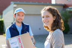 Young attractive delivery man on his way to customer Stock Image