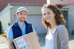 Young attractive delivery man on his way to customer Stock Photography