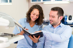 Young attractive dentist programs next date Stock Photography