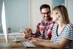 Young attractive designers working on project together stock images