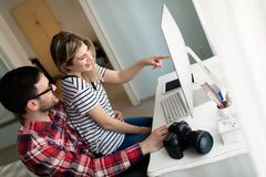 Young attractive designers working together from home. Young attractive designers working together from their home Stock Photo