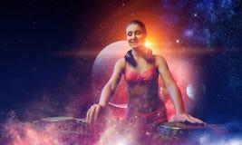 Cute dj woman. Mixed media. Young attractive dj woman in bikini playing her music. Mixed media stock image