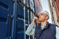 Young attractive docker checking security system Stock Images