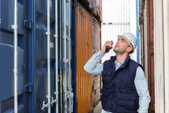 Young attractive docker checking security system Royalty Free Stock Photos