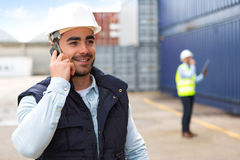 Young Attractive docker using mobile phone at work Royalty Free Stock Photo