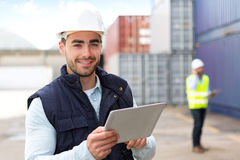 Young Attractive docker using tablet at work Royalty Free Stock Photos