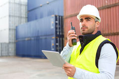 Young Attractive docker using tablet at work. View of a young Attractive docker using tablet at work Royalty Free Stock Images