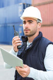 Young Attractive docker using tablet at work Stock Images