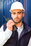 Young Attractive docker using talkie walkie at work Royalty Free Stock Photography