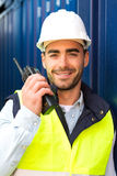 Young Attractive docker using talkie walkie at work Royalty Free Stock Images