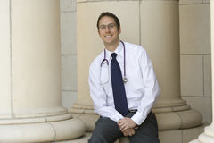 Young Attractive Doctor. A young doctor smiles outside his office during the workday Stock Photos