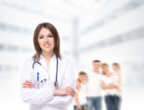 Young attractive doctor on a blurry background Royalty Free Stock Image